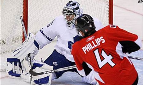 phillips_chris_sens_toskala_vesa_leafs_action_480x285.jpg